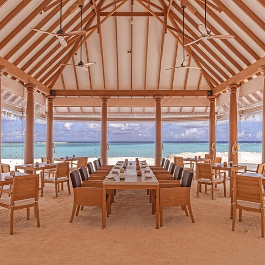 Outdoor restaurant by the beach at Heritance Aarah