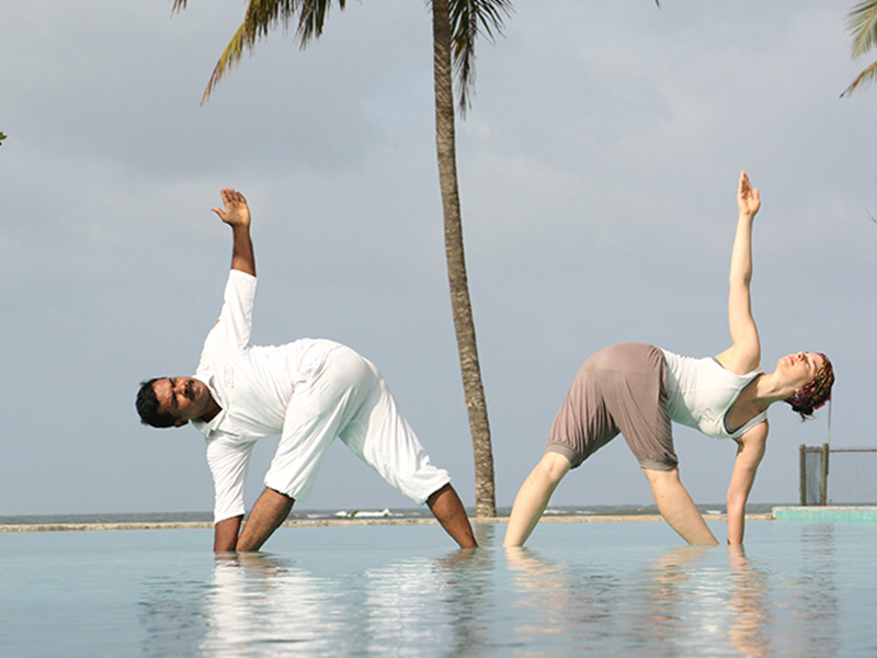 Two individuals practicing Yoga