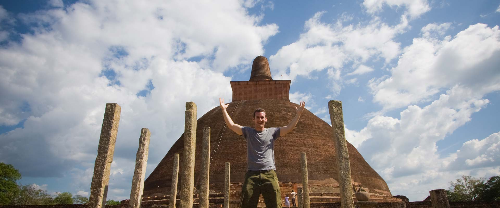 An overjoyed tourist in ancient temples in Polonnaruwa