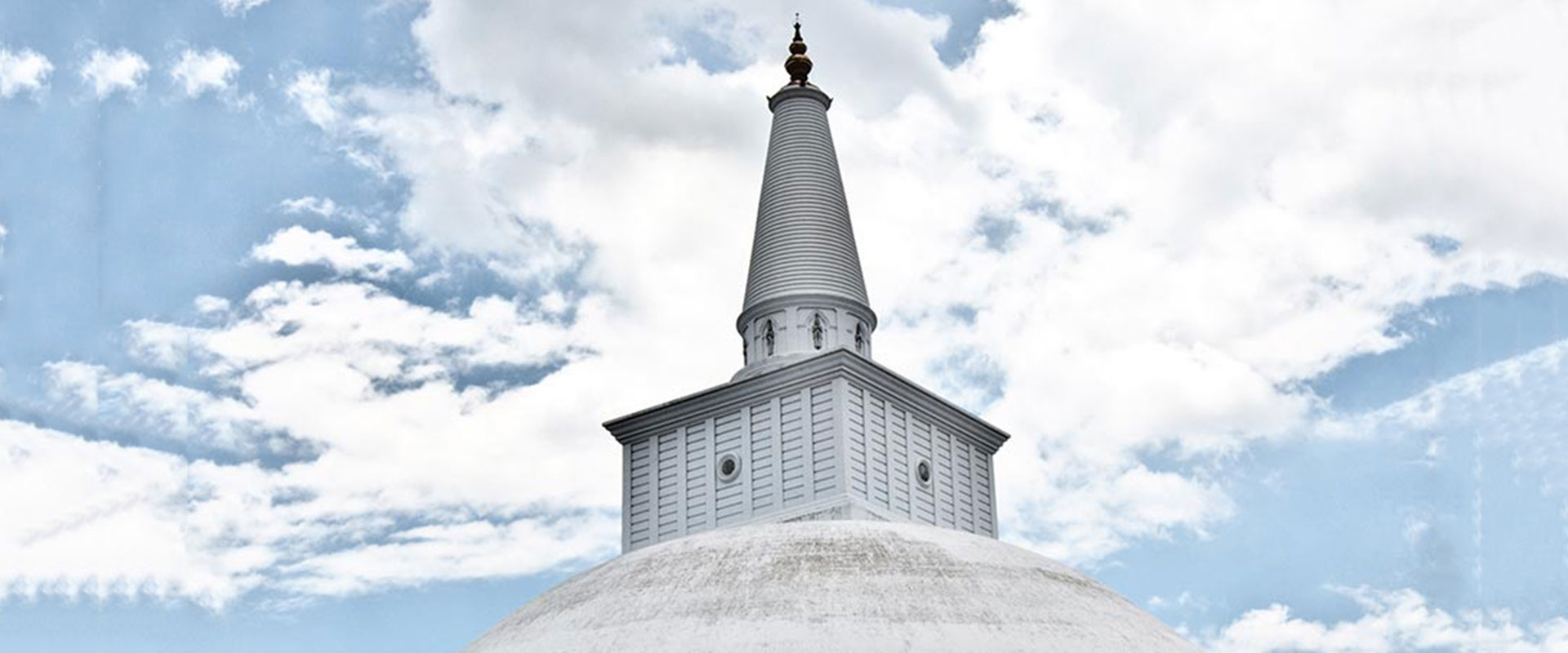 Temple Stupa in Anuradhapura with a cloudy sky