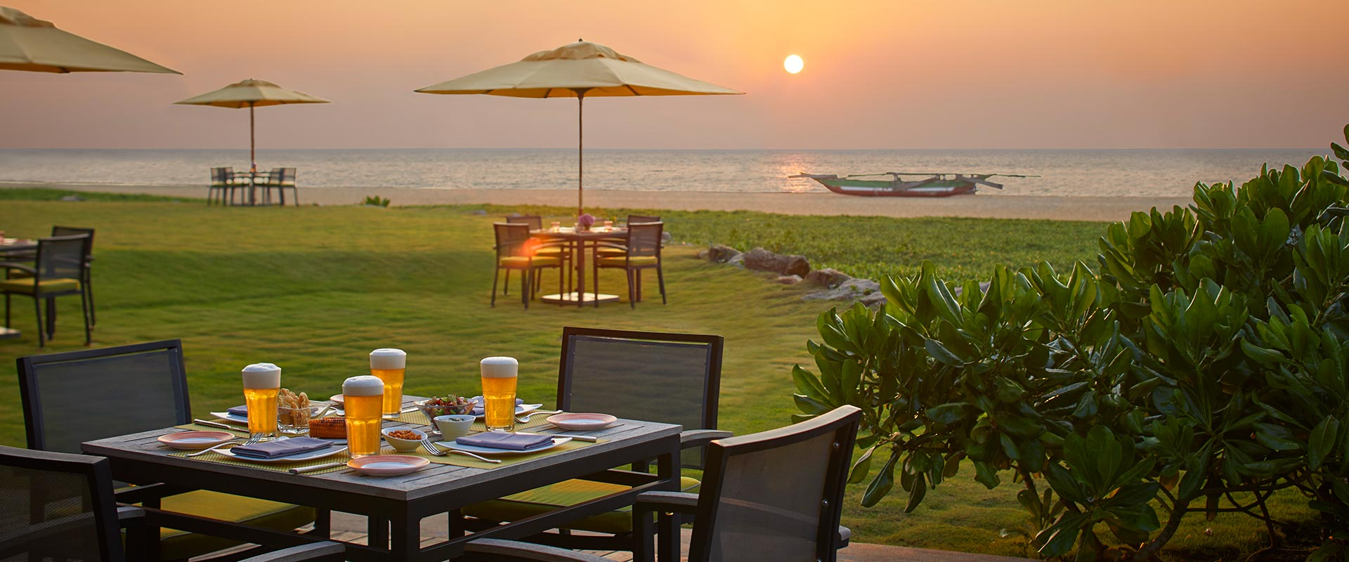 B-Bums Bar Outdoor Dining with a sunset view at Heritance Negombo
